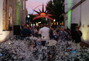 Musicians playing at the Children's Plaza fountain during a Phoenixville First Friday.